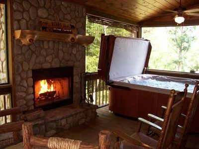Move the hot tub outside and build a roof overtop to help keep the weather out. Maybe add screen to the open parts