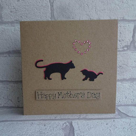 Unique Happy Mothers Day card with a mother cat and kitten silhouette and gem heart.  This handmade cat and kitten card for Mum / Mom has a silhouette of a cat and a kitten with gems in the shape of a heart. The colour of the shadow of the cat and the gems can be selected from the drop-down menu on this Mothers Day cat card. The sentiment on this Mothering Sunday card is added with 3D foam and reads: Happy Mothers Day. This would be a perfect card for a Mum from a Son or Daughter.  PERSO...