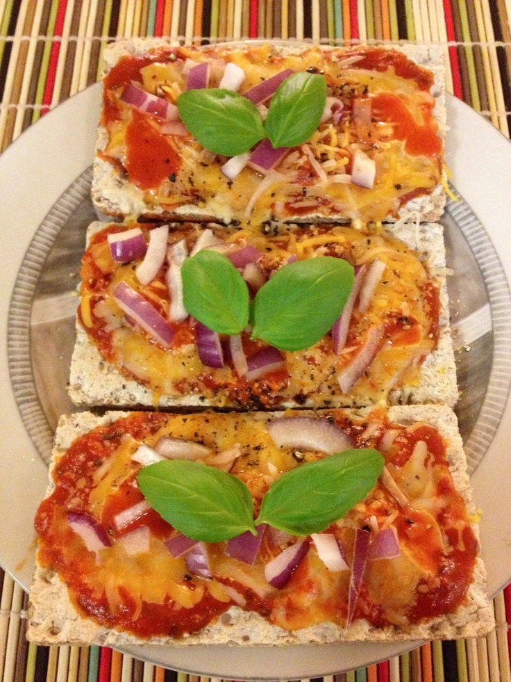 Wasa, pizza sauce, red onions, peppers, cheese, bacon pieces, etc.