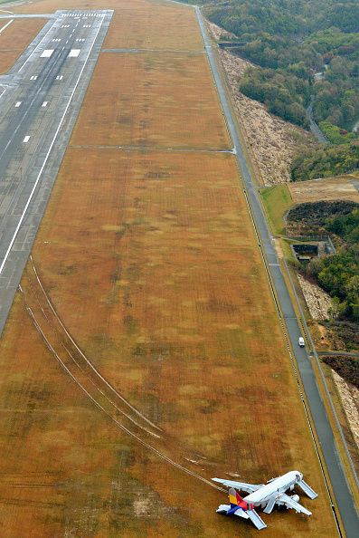 In this aerial image Asiana Airlines Flight 162 skidded off the runway on…