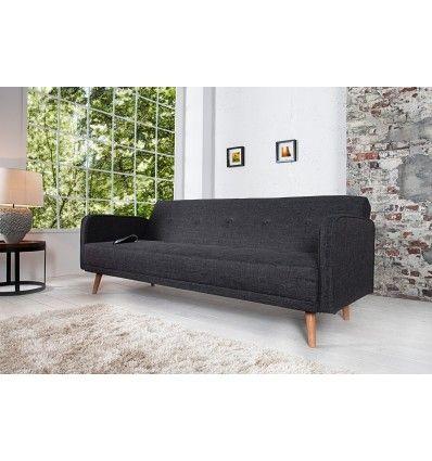 Un canapé confortable trois places convertible, revêtement en tissu coloris anthracite,piétement de style scandinave. Sa structure robuste en bois vous assu...