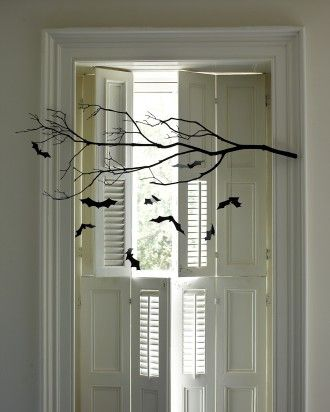 Spray paint a branch black then using contruction paper cut out bats & strig them up.