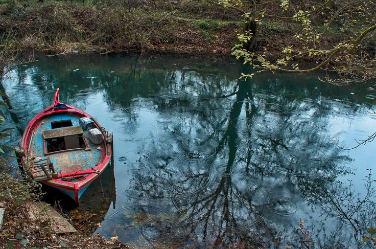 Rainy lake and the red boat by Odysseas Megalooikonomou - Photo 144257911 - 500px