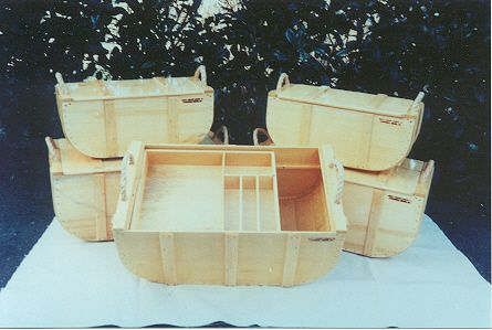 Beautiful Wannigans... A wannigan is a traditional piece of gear that is used to pack fragile equipment or used as a food box on canoe trips. It is   nothing more then a wooden box, and can be any size or shape that is needed. It is carried with a tumpline or a pack   board.