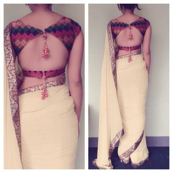 Beautiful multicolored blouse with simple white saree!