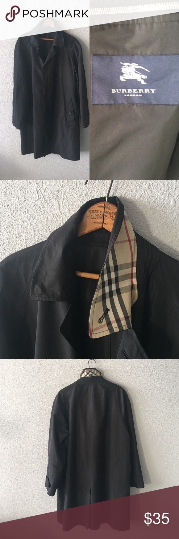 Men's Black Raincoat In great condition! I can't guarantee the authenticity. Made of nylon and fits like a men's L/XL. Chest measures 47 inches and length is 36.5 inches. Jackets & Coats Raincoats