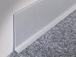 This is a metal skirting board which is available in anodised aluminium or stainless steel in different finishes and heights, allowing you to create an elegant and refined wall-to-floor connection.The aluminium metal skirting profile is designed to sit on top of the floorcovering in order to provide a neat finish.The metal skirtings may be used for all floor coverings.