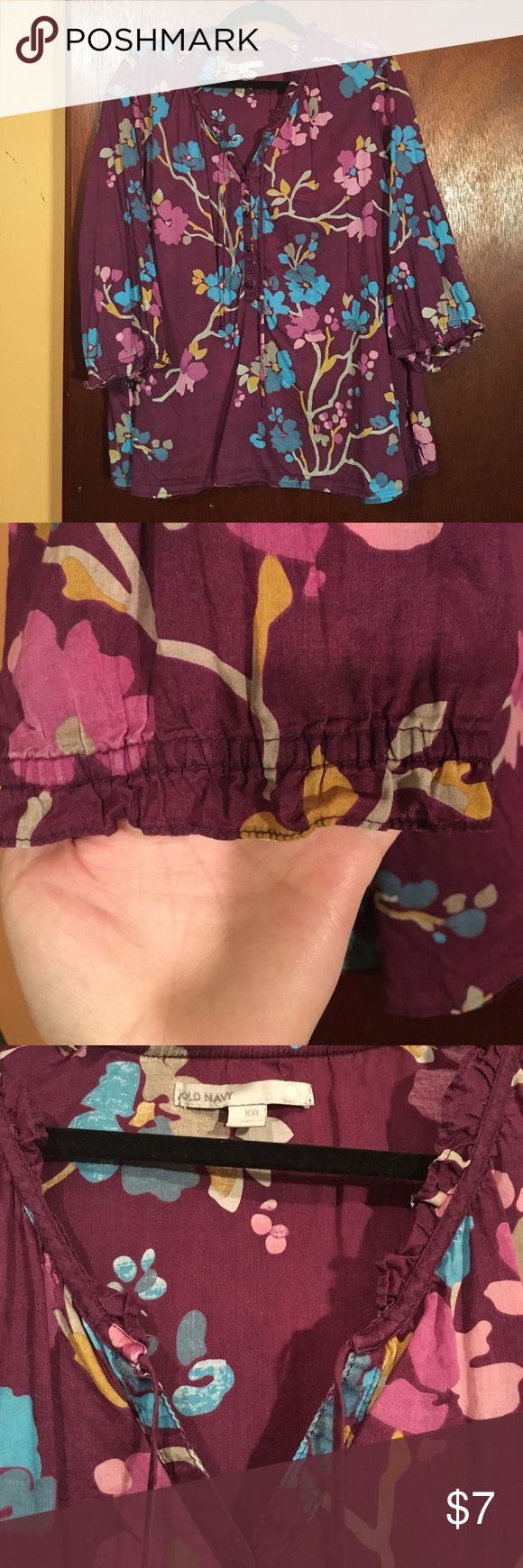 Old Navy XXL purple floral career top boho gypsy For sale is a pretty purple floral career top with partial putt on front, tie at the neck and little ruffles on the neck and sleeves. It is lightweight and I used to wear something underneath because I got cold easy but if you're hot natured you're in luck 😊. Sleeves are 3/4 and I'd say it's hip length but it's definitely not cropped. Meant to have a slightly faded look for boho chic. Give it s home! 🌸💗 Old Navy Tops
