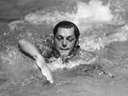 Tyler Vlcek and Casey Olsen. Picture of Johnny Weissmuller. He set many swimming records in the 20's