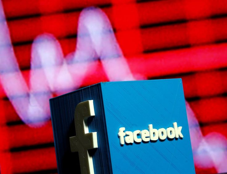 A 3D-printed Facebook logo is seen in front of a displayed stock graph in this illustration taken November 3, 2016.  REUTERS/Dado Ruvic/Illustration - RTX2RSMQ