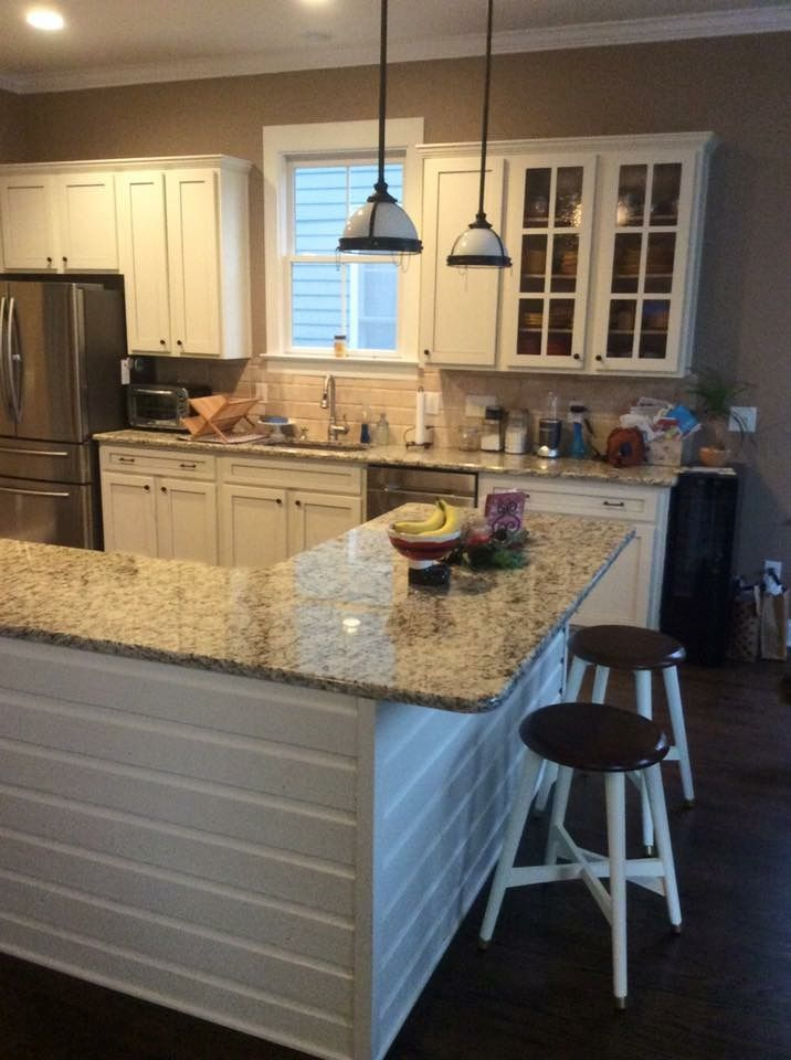 Reclaimed Dutch lap siding on island. Painted cabinets. Deface shaker doors