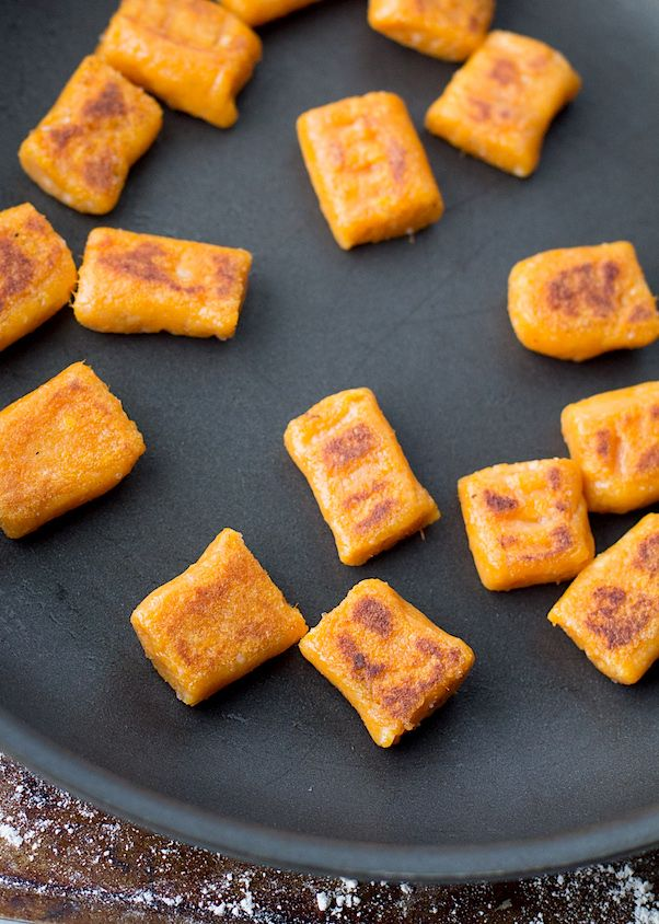 Easy 5 ingredient Gluten-Free Sweet Potato Gnocchi are like a homemade pasta dream! Crisp on the edges, fluffy inside. No eggs or cheese so vegan too!