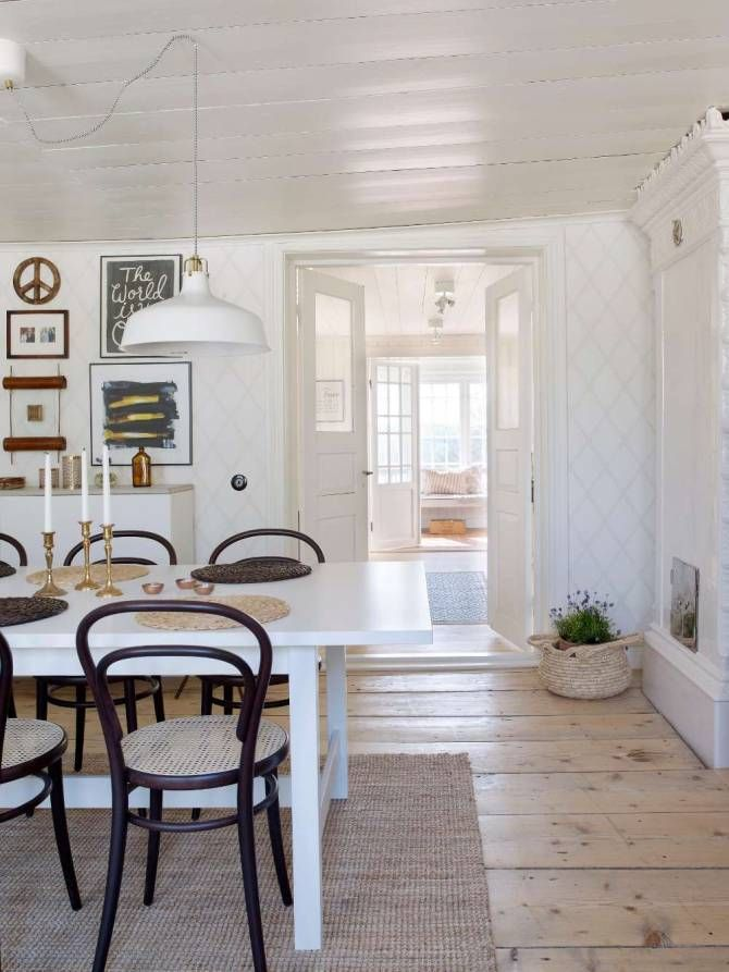 Dining room's wide floorboards could be saved when the couple renovated. Wallpaper, Louis, from Sandberg.