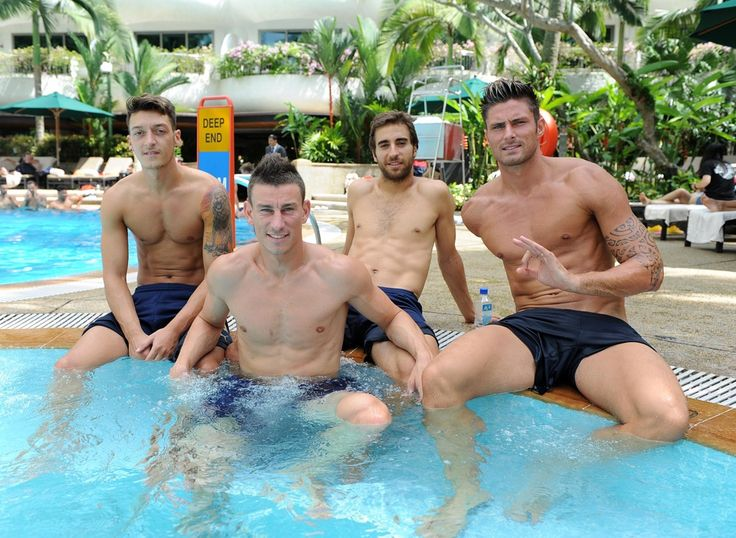 The Arsenal squad made quite a splash in Singapore!  After a series of intense training sessions in humid conditions and their match against a Singapore Select XI, they had a recovery session in the pool.