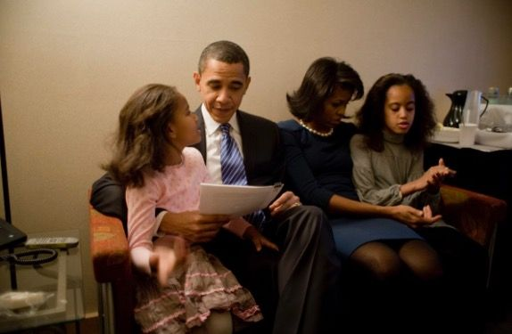 #44thPresident #BarackObama reads over his victory speech with daughter, Sasha, while his wife, Michelle, talks to daughter, Malia in a holding room at the Hy-Vee Center in Des Moines, Iowa in January 2008. Barack Obama had just won the Iowa Caucus for the Democratic ticket #ObamaFamily #People lMagazine #ObamaHistory #ObamaLibrary #ObamaFoundation Obama.org