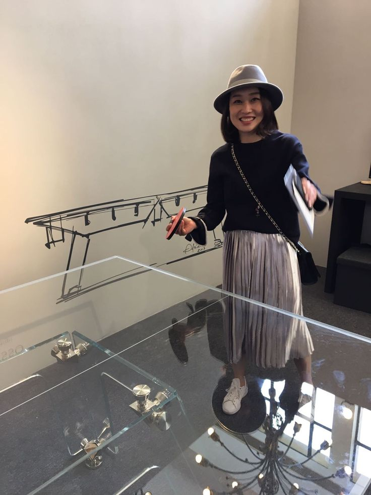 Lovely Chinese girl playing on an amazing ping pong table made of crystal glass. That's Lungolinea pingpong table in Shanghai!  #design #madeinitaly #pingpong #tennistable #crystal #table #luxury #furniture #interiors #inspiration