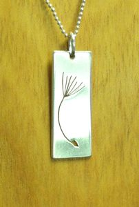 """A dandelion seed cut-out on a 18"""" sterling silver chain - Made by Lex - Available in store"""