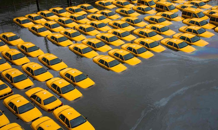 A parking lot full of yellow cabs is flooded as a result of Superstorm Sandy in Hoboken, NJ. So far we're already committed to about 1.7 meters (5.5 feet) of eventual sea level rise.