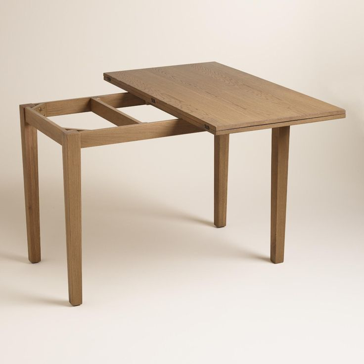 Crafted of solid oak with oak veneers and a light oak finish, our convenient console table expands into a small dining table with a simple flip of its top. This exclusive, high-quality convertible table is perfect for small spaces both open and closed.