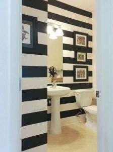 Amazing black and white vinyl striped bathroom in military housing! No paint required! - White Walls Online