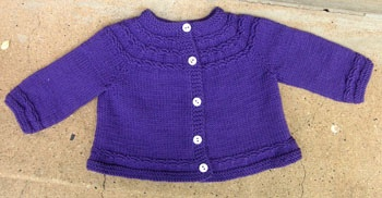 this pattern on Ravelry:  http://www.ravelry.com/patterns/library/seamless-yoked-baby-sweater     -   Debbie bliss rialto