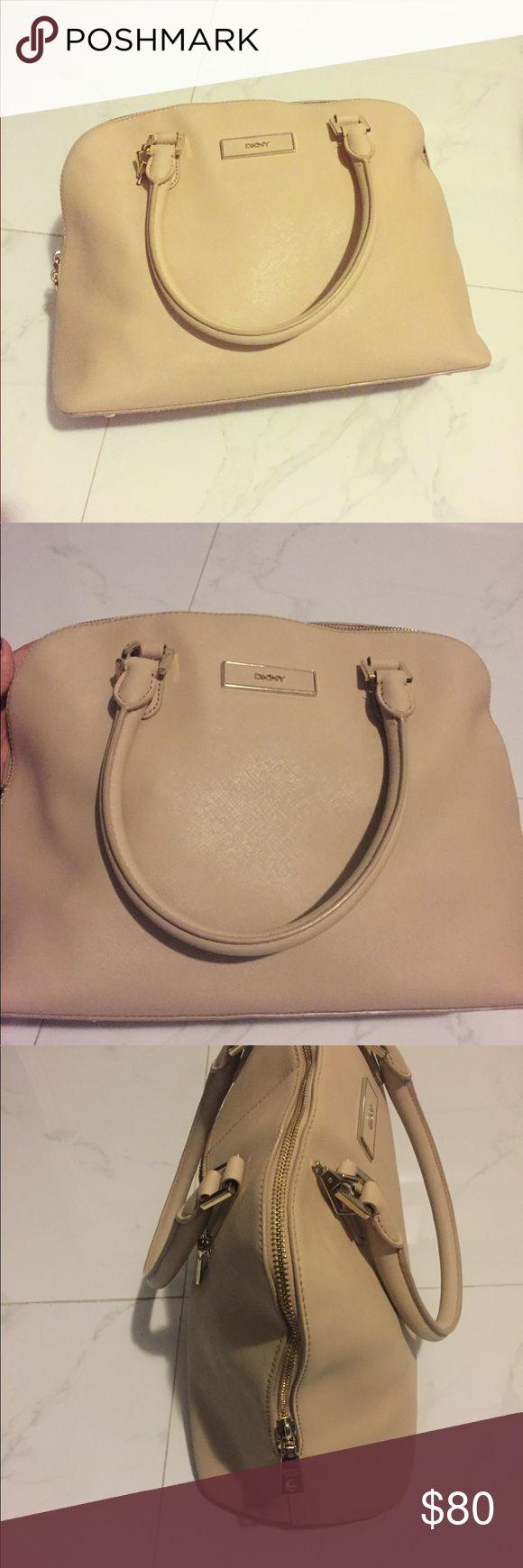Tan DKNY Handbag Gorgeous tan DKNY handbag with top handle. Great condition! Dkny Bags