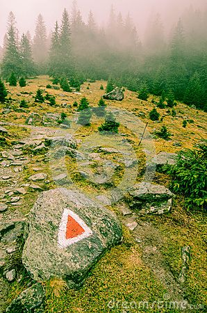Red triangle guide on Foggy Transylvanian mountain tracking
