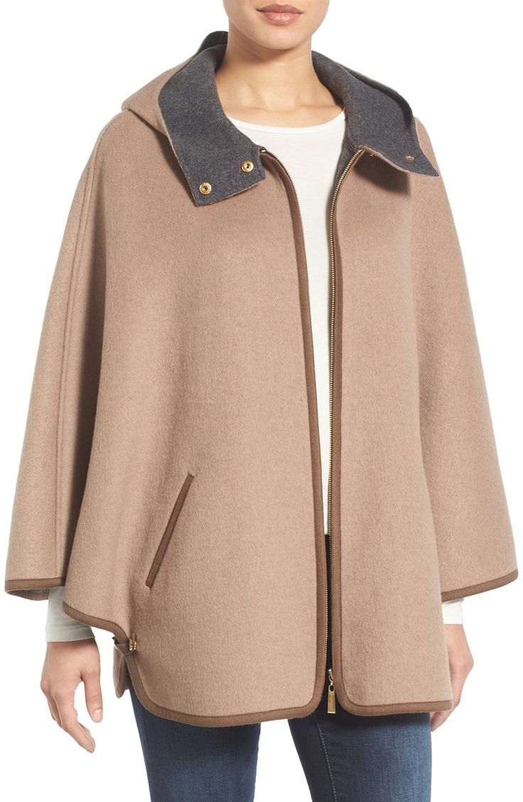 Swooning over this wool cape coat that is perfect for layering on cold days. A double-faced design offers peeks of contrast color while detailed with gorgeous gold hardware.