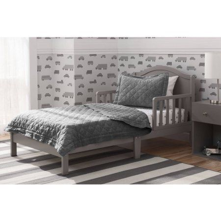 """Beautifully built from strong and sturdy wood, the Baker Toddler Bed from #Delta Children will help make the transition to """"big kid"""" bed easy. Boasting a bell-sh..."""