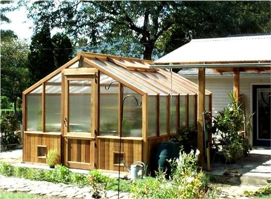Cedar Greenhouse Right Next To Carport And Rain Catching Barrel;