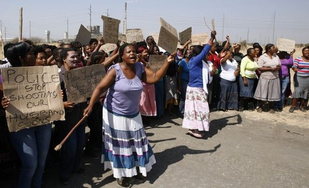 Marikana: A year on | The day after the massacre, wives and mothers of the mine workers protest against the police. Photo: Themba Hadebe, AP