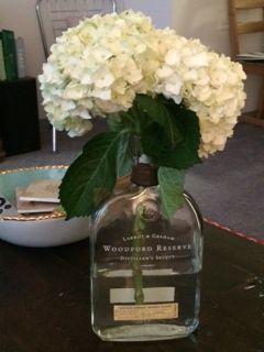 Wedding center pieces Bourbon bottle vase, woodford, hydrangea