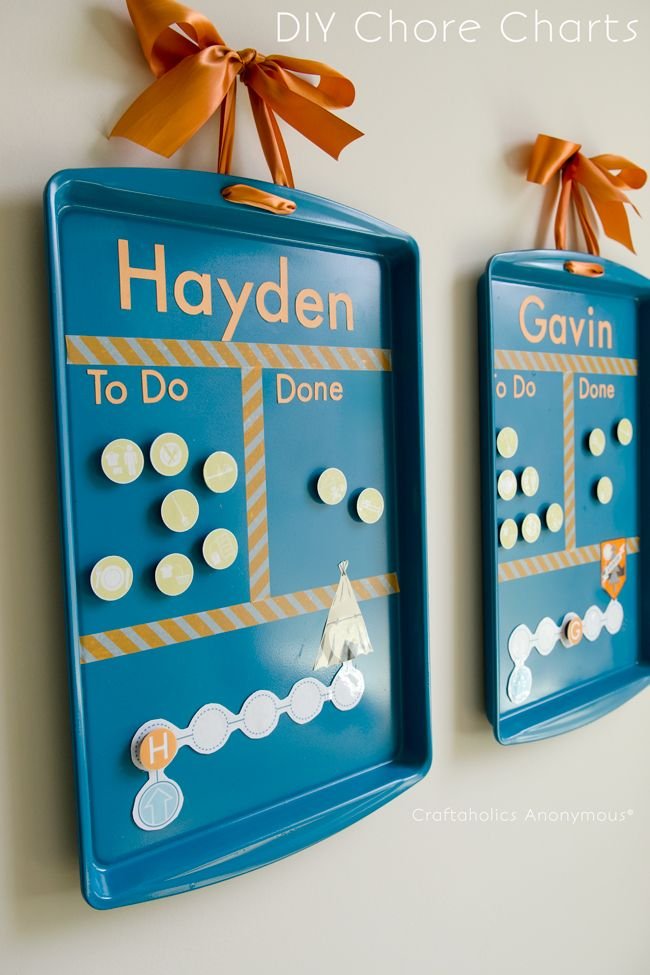 Cookie sheets turned into chore charts. Brilliant! Cheap + they're magnetic.