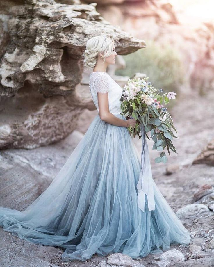 This absolutely **stunning** wedding gown is by Chantel Lauren Designs // Photo by Tyler Rye Photography #favorite #blue