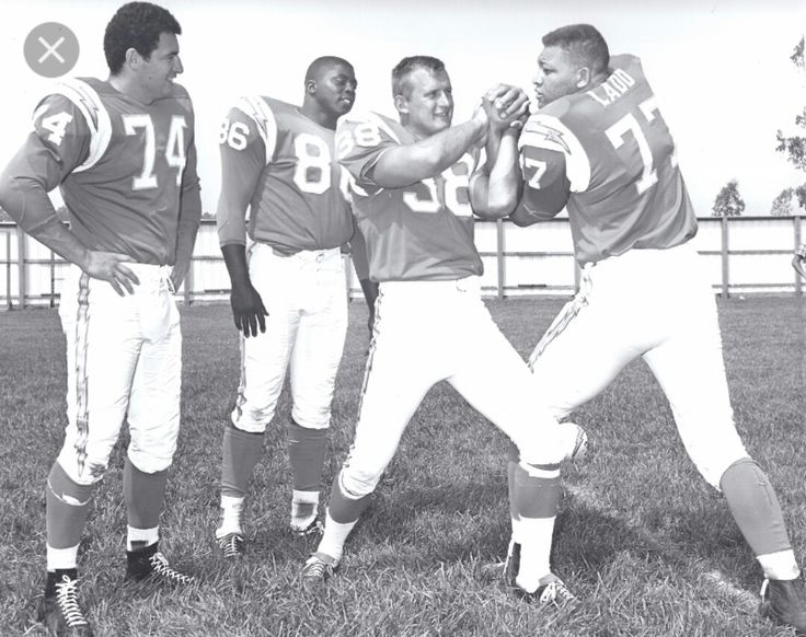 Ron Mix (74), Earl Faison (86), Jack MacKinnon (38) and Ernie Ladd (77) / San Diego Chargers