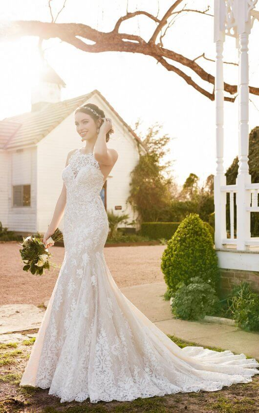 874 Lace High Neck Wedding Gown by Martina Liana. Find this dress at Janene's Bridal Boutique located in Alameda, Ca. Contact us at (510)217-8076 or email us info@janenesbridal.com for more information.