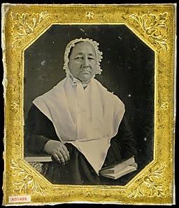 Woman (Quaker? / Shaker?) wearing pelerine collar, daycap, holding book.: Hold Books