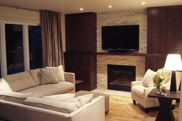 Living room space designed by Glen & Jamie from Peloso Alexander Interiors. #GlenandJamie #Design #fireplace #sofa #chair #lamp #tv