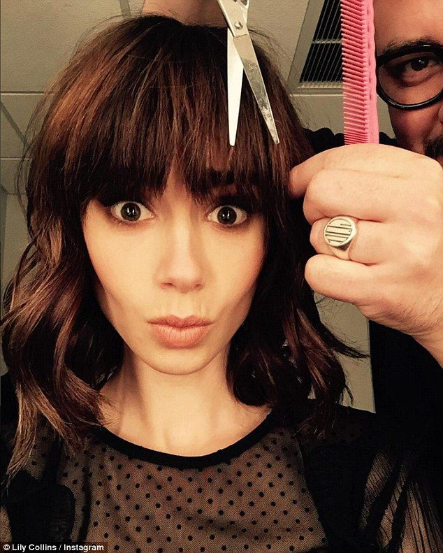Changed her look: Later on Wednesday night, she posted this selfie to her Instagram pulling a face as a stylist appeared to chop at her fringe with scissors creating new blunt bangs