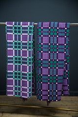 Matched pair of hand woven real wool reversible Welsh blankets.
