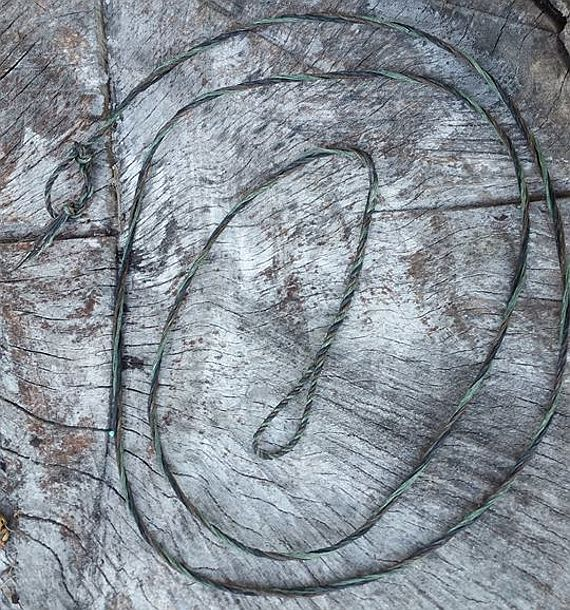 A three-bundle single-loop flemish twist bowstring from Humble Archery https://www.etsy.com/shop/HumbleArchery?ref=hdr_shop_menu&section_id=20244631