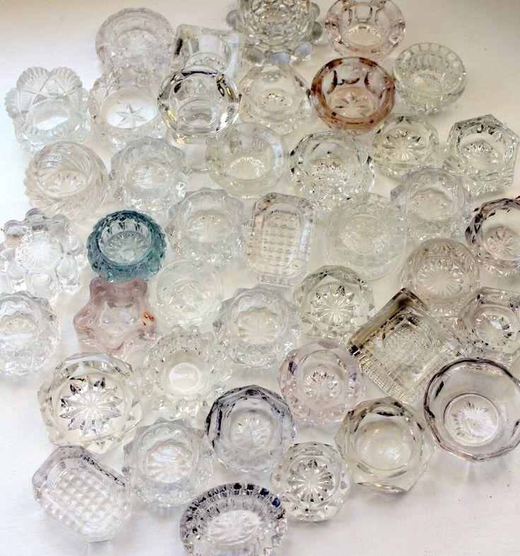 vintage & antique salt dips make for pretty ring organization on a vanity.