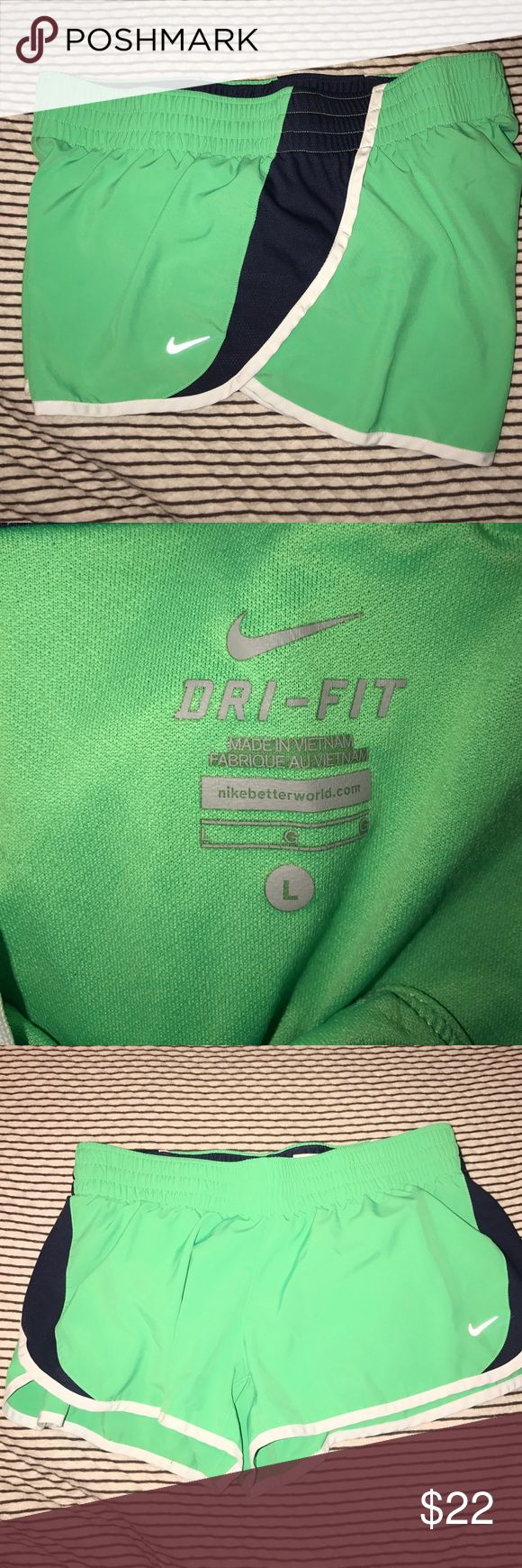 Nike lime green running shorts! Size Large. Lime green and blue. Like new! Nike Pants Track Pants & Joggers