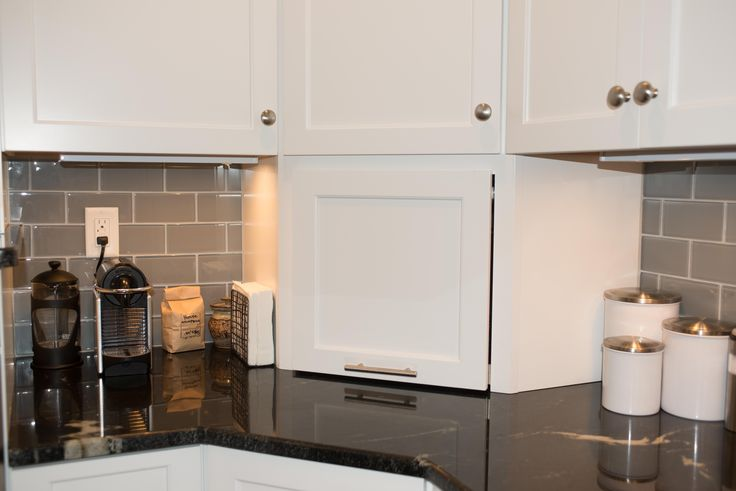 The corner appliance garage is a great place to store a blender, toaster oven, and other small kitchen appliances when they are not in use.