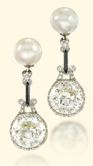 EARLY 20TH CENTURY DIAMOND AND NATURAL PEARL EAR PENDANTS / Each designed as a circular-cut diamond weighing 7.23 and 6.64 carats to the natural pearl surmount, with onyx and diamond connecting links / circa 1920