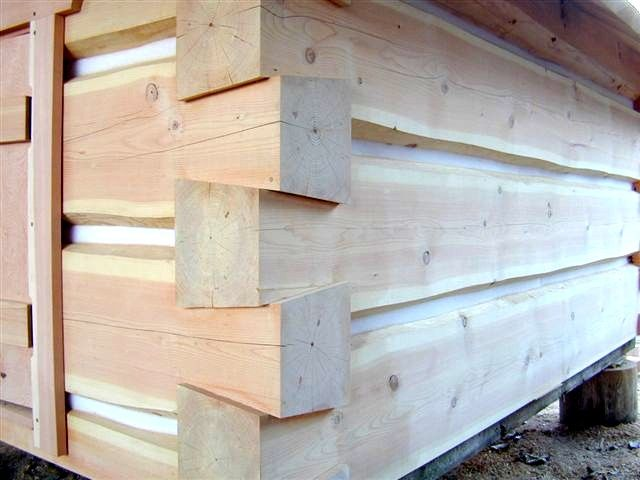 How to build a log cabin with dovetail notches
