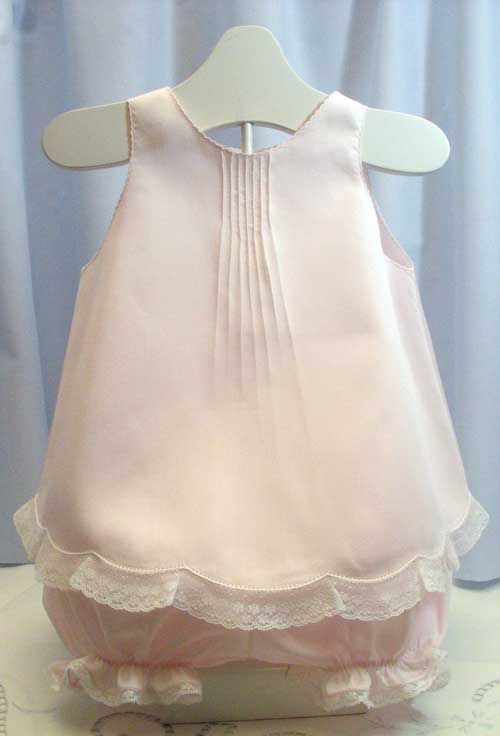 Debbie Glenn is a designer, author, and teacher who specializes in fine machine and heirloom sewing, recreating handwork by machine, plus appliqué and smocking.  Debbie wrote about this Dainty Heirloom Diaper Set: It is a lace-trimmed, satin-batiste Gertrude-style topper and matching panties for a special summer baby! #baby #sewing