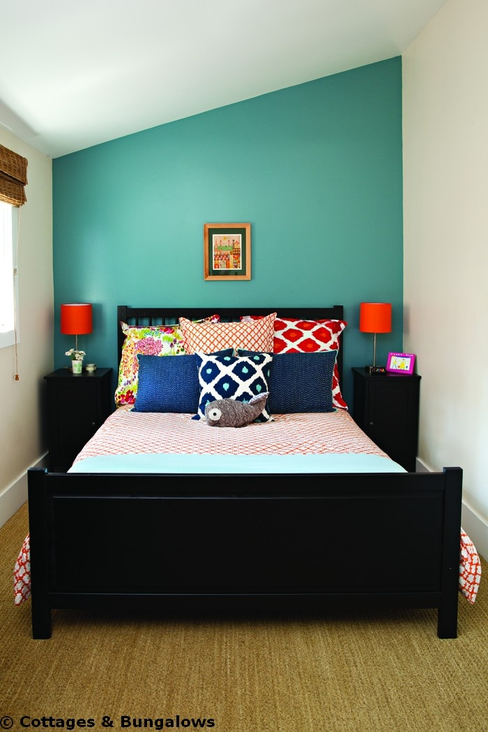 Hmmm.... brightly colored focal wall, completely random pillows, actually comes together quite nicely.