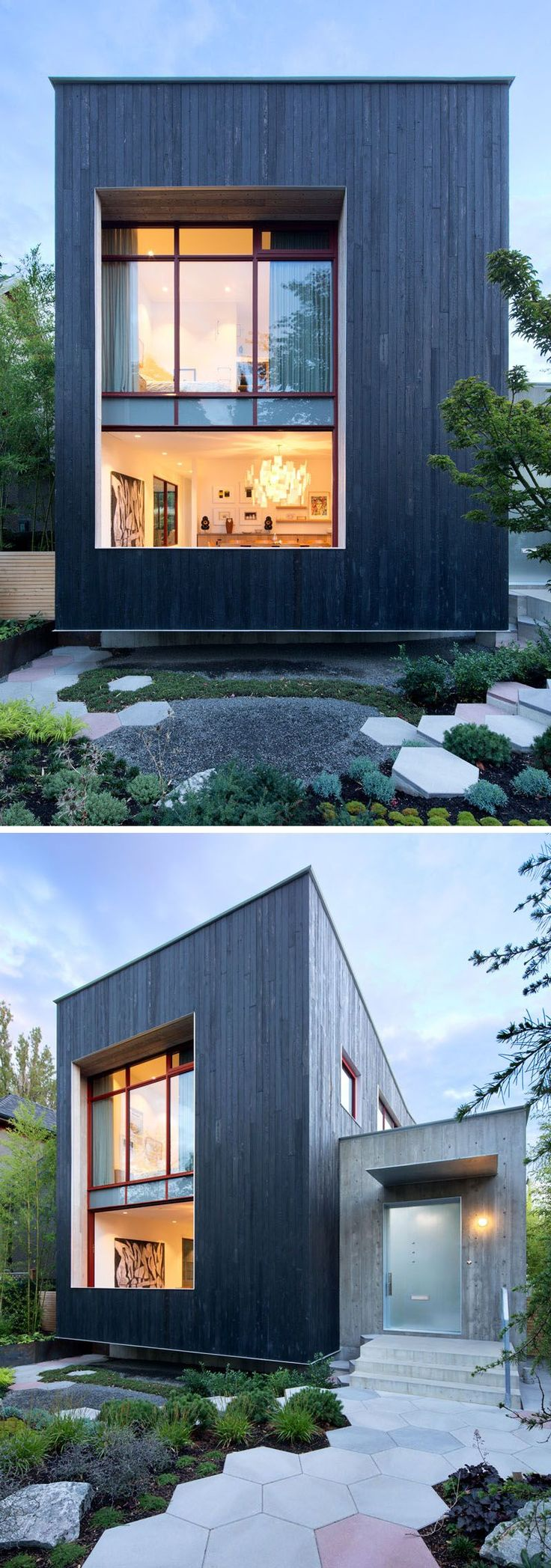 The exterior of this modern house is covered in carbonized cypress exterior cladding, giving it a bold and dark appearance, while hexagon stepping stones guide visitors to the front door.