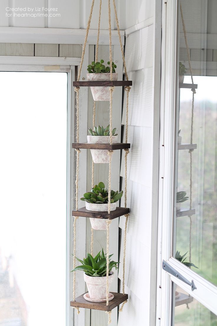 This hanging planter is a perfect way to also use up some wood scraps.  If the wood was whitewashed and the planters were painted a pale aqua. Dans le Lakehouse: 20 Innovative + Modern Ideas for Decorating with Rope